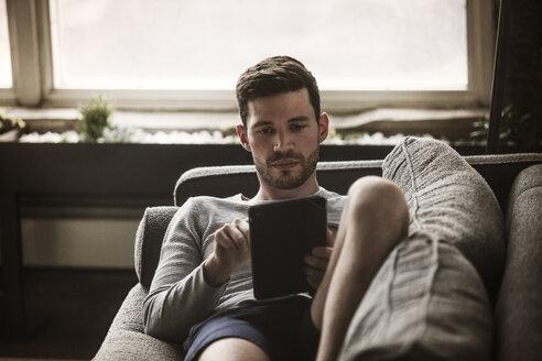 Man using tablet computer at home - CAVF01180