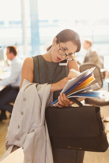 Stressed businesswoman struggling to multitask in office - CAIF06663