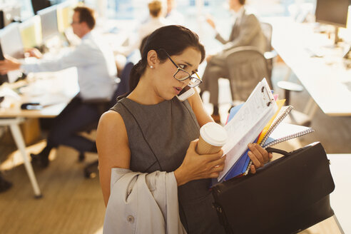 Stressed businesswoman struggling to multitask in office - CAIF06681