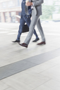 Corporate businessmen walking with coffee - CAIF06789