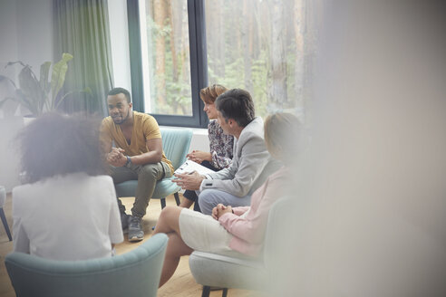 People listening to man in group therapy session - CAIF06852