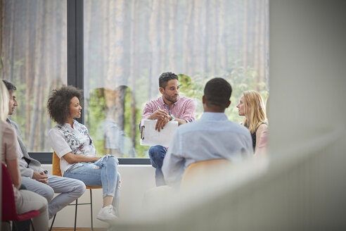 People talking in group therapy session - CAIF06861