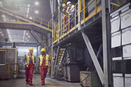 Steelworkers walking in steel mill - CAIF06963