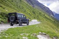 Italy, Piemont, Landrover on gravel road - MMAF00300