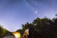 Italy, Piemont, yellow tent, landrover, milky way and starry sky at night - MMAF00324