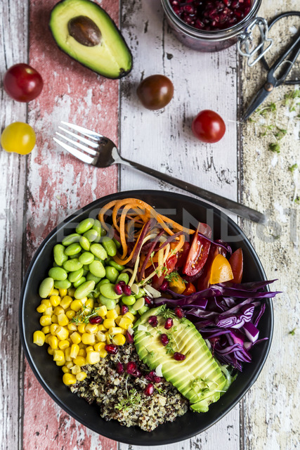 Quinoa veggie bowl of avocado, Edamame, tomatoes, corn, carrots, red cabbage and pomegranate seed - SARF03593