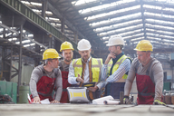 Male foreman, engineers and workers meeting in factory - CAIF07260