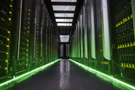 Glowing panels in dark server room - CAIF07407