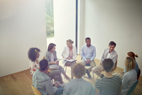 People talking in a circle in group therapy session - CAIF07485