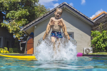 Father and son having fun in swimming pool - KNTF01094