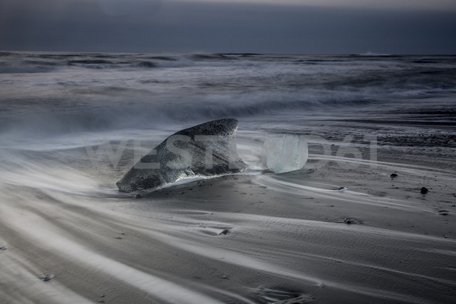 Ice on stormy cold ocean beach, Iceland - CAIF07513