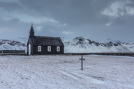 Church and graveyard in snowy remote mountain landscape, Budir, Snaefellsnes, Iceland - CAIF07528