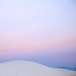 Pink sunset sky over white sand dune, White Sands, New Mexico, United States - CAIF07591