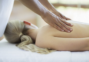 Woman receiving massage at spa - CAIF07777