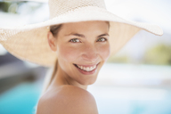 Portrait of smiling woman in sun hat - CAIF07789