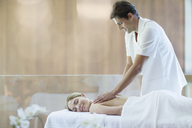 Woman receiving massage at spa - CAIF07792