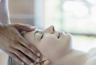 Woman having scalp massage in spa - CAIF07819