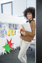 Portrait of smiling businesswoman in office - CAIF07897