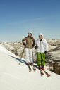 Portrait of skiers standing on snow covered field - CAVF01395