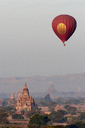 Htilominlo Temple and hot air balloon against sky - CAVF01413