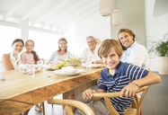 Family smiling together at table - CAIF07950