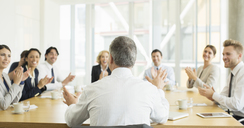 Business people clapping in meeting - CAIF08025