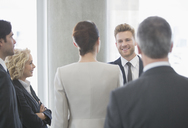 Business people talking in office - CAIF08031