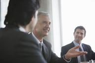 Businessmen talking in meeting - CAIF08034