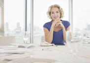 Businesswoman sitting in restaurant - CAIF08043