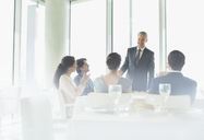Businessman talking in restaurant - CAIF08082