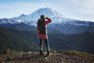 Rear view of woman looking at snowcapped mountain - CAVF01791