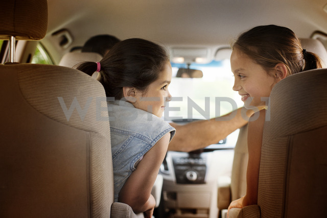 Rear view of girls traveling in car - CAVF02235