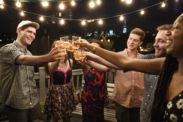 Cheerful friends toasting drinks at party - CAVF02262