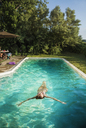 High angle view of woman swimming in pool - CAVF02301