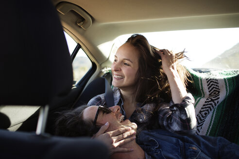 Cheerful couple traveling in car - CAVF02748