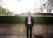 Portrait of smiling young businessman on sunny day - CAVF02922