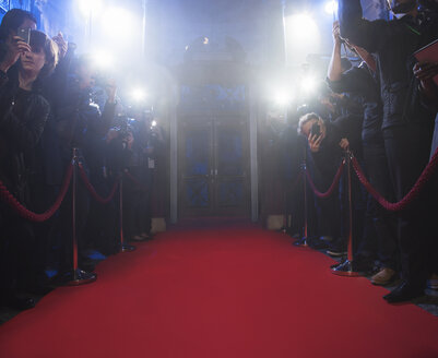Paparazzi using flash photography along red carpet - CAIF08160