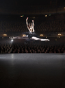 Ballerina mid-air on theater stage - CAIF08226