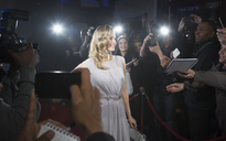 Female celebrity posing for paparazzi on red carpet - CAIF08241