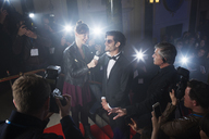 Celebrity being interviewed on red carpet - CAIF08262