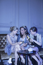 Well dressed women drinking champagne in luxury nightclub - CAIF08289