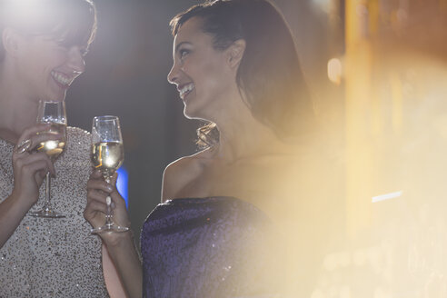 Well dressed women drinking champagne in luxury bar - CAIF08307