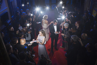 Well dressed celebrities signing autographs on red carpet - CAIF08349