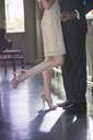 Low section of well dressed couple hugging - CAIF08397