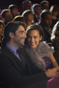 Smiling couple in theater audience - CAIF08403