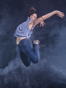 Young woman jumping in the air - STSF01480