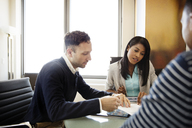 Business people planning while sitting at desk - CAVF03782