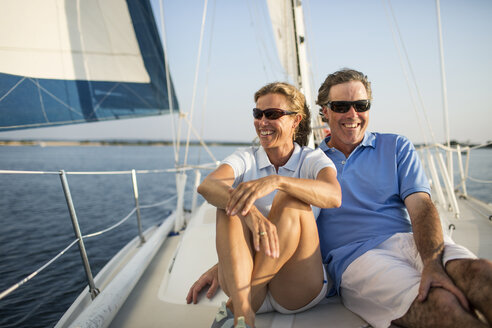 Smiling couple traveling in yacht - CAVF03941