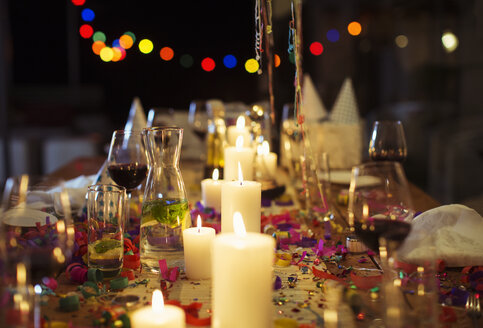Lit candles on table at party - CAIF08478