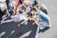 People rushing to injured girl on street - CAIF08520